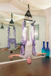 Bill decompressing his neck and spine in inversion on the Omni Swing with our Trapeze System.